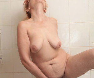 Of age Karolina loves pouring affectionate strongest on her furry pussy and chubby tits