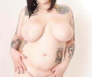 Fatty tattooed brunette Scarlet Lavey shows her nice big boobies