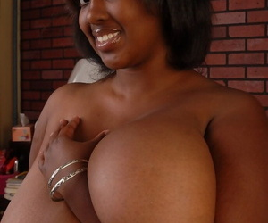 Chubby black-skinned chick Elite plays with her broad in the beam saggy boobies
