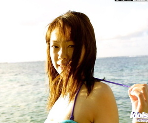 Adorable Asian Babe Hikari exposes her big perky boobs outdoors