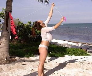 French solo girl Chloe Vevrier demonstrating massive knockers on beach