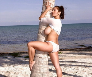 French matchless girl Chloe Vevrier demonstrating titanic titties atop lakeshore