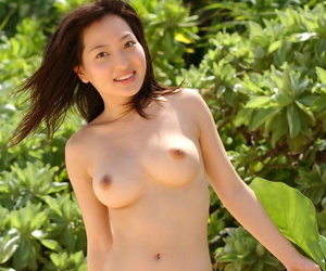 Amazing asian babe with big tits stripping off her bikini outdoor