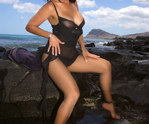 Of age pamper in pantyhose and sun glasses goes topless at bottom along to seashore