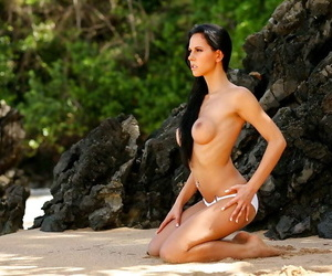 Snoutfair brunette poses naked in a place that looks like paradise
