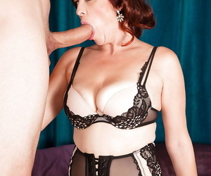 Chubby over 40 MILF Susanna Adams giving big cock a bj in lingerie and hose