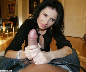 Seductive mature brunette gives a handjob and gets a cumshot on her tits