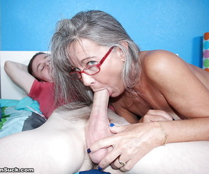 Glasses adorned granny sucks added to tugs surpassing a younger mans unearth