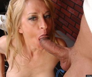 Older blonde interrupts workout session to give big cock ball licking bj