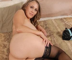 Mature SashaSky plays with her nice-looking big natural boobies