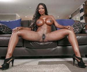 Leggy older ebony babe Diamond Jackson unleashing huge oiled tits