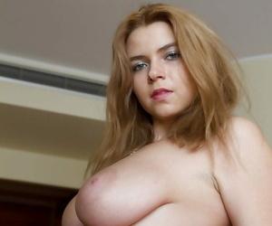 Erotic Italian babe Marina Visconti exposing colossal all innocent boobs
