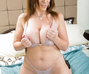 Busty cougar Sara Jay strips added to flaunts big phat pain in the neck superior to before wainscot