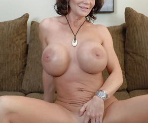 Full-grown babe Deauxma undressing her huge breast and shaved pussy