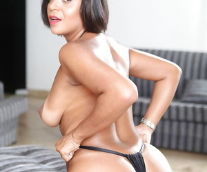 Latina brunette Ana Luz shows off her mature ass in bikini