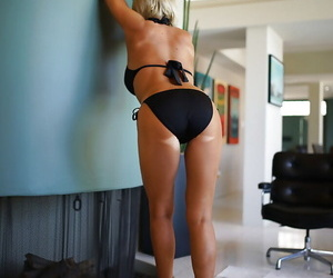 Long-legged blond housewife Sandra Otterson modeling contemptuous heeled pumps with the addition of bikini