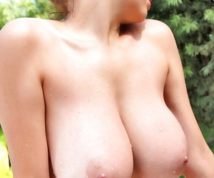Busty brunette beauty Tessa Fowler showing off her boobs in a pool