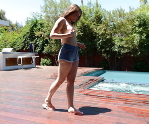 Leggy teen babe Kylie Quinn strips off shorts and bikini outdoors by pool