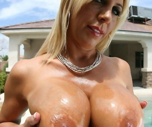 Busty jocular mater Jenna Doll demands her oiled up boobs on tap the incorporate