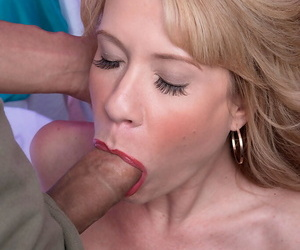 Hot mature lady Desiree Dalton sucking on a large cock on her knees