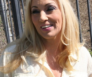 Blonde cougar Cala Craves bangs two big black cocks at the same time