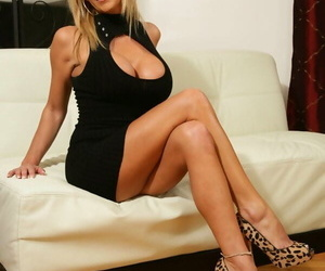 Leggy blonde wife Misty Vonage takes off her black dress for nude poses