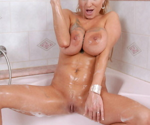 Big titted middle-aged lady Sharon Pink toys her pussy while taking a bath