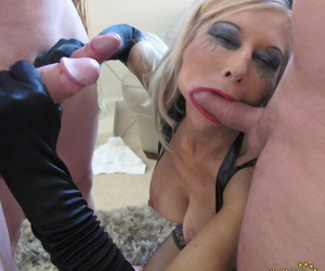 Blonde slut Blondie Blow is the center of attention during a blowbang