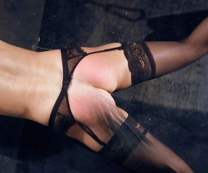 Pretty blonde sub in black stockings gagged & bound legs spread for hot wax