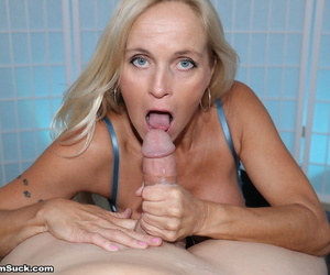 Older blonde woman Dani Dare pulls out her big tits while sucking cock