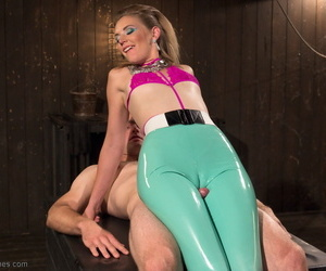 Clothed chick Mona Wales tortures a mans dick with the tease of latex pants