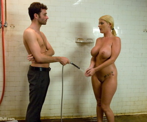 Naked blonde chick Sophie Dee squirts water out her ass after an enema