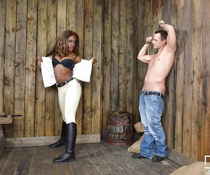 Eccentric Ebony mistress Maria Ryder enjoying some good-luck piece fueled BDSM simulate