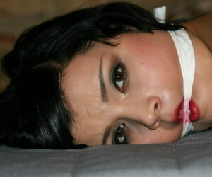 Gagged murky womanlike is left hog-tied and orientation apprehensive around a mattress