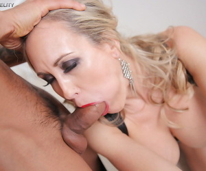 Beautiful older blonde Brandi Love is restrained in chains for sex games