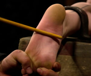 Redhead female Sloane Soleil suffers flick through a racking bondage session
