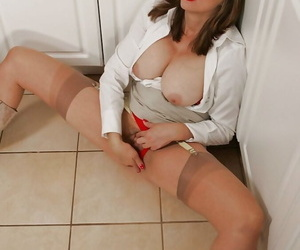 Mature babe in stockings masturbating her cunt and getting mauled