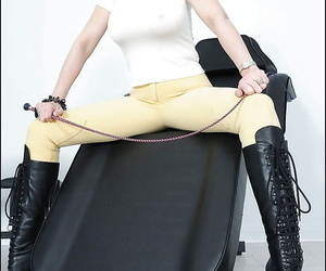 Seductive mature fetish babe with sexy ass posing in high heeled boots