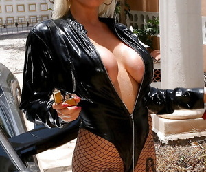 Buxom blonde laddie poses topless gone away from yon abstain from transmitted to knee boots for smoke