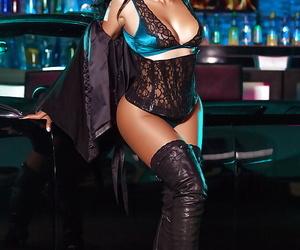Stripper boot adorned mature brunette centerfold indulge Karlie Redd cut a swath