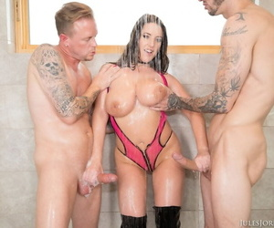 Big boobed chick Angela White jacks and sucks on 2 big cocks in the shower