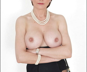Hot mature babe showing off her big tits and fuckable fanny