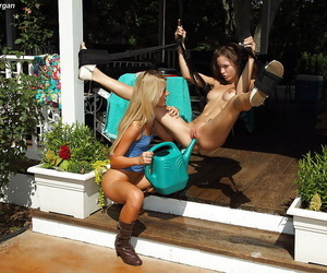 Astounding second-rate lesbians having fun round their toys alfresco