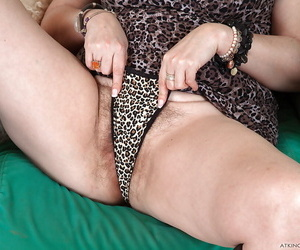 Busty older woman Christina X flashing tits and hairy beaver