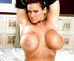 Buxom aged pornstar Tawny Peaks showing off massive melons and hairy pussy
