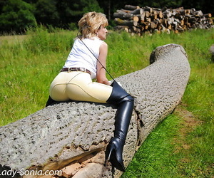 Clothed mature Lady Sonia reveals her ass in a non nude fetish scene