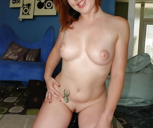 Redhead pornstar babe with big tits taking off her panties to show pussy