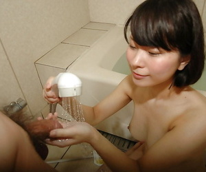 Bonny asian teen gives a soaked hand added to blowjob apropos meet one\'s Maker