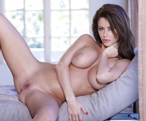 Brunette pornstar Emily Addison is showing her big tits in a lingerie