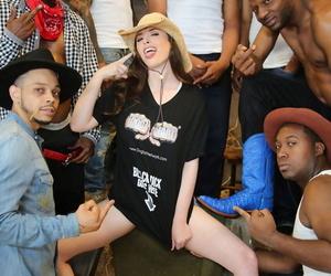 Small titted babe Casey Calvert enjoys an interracial gangbang in a stall